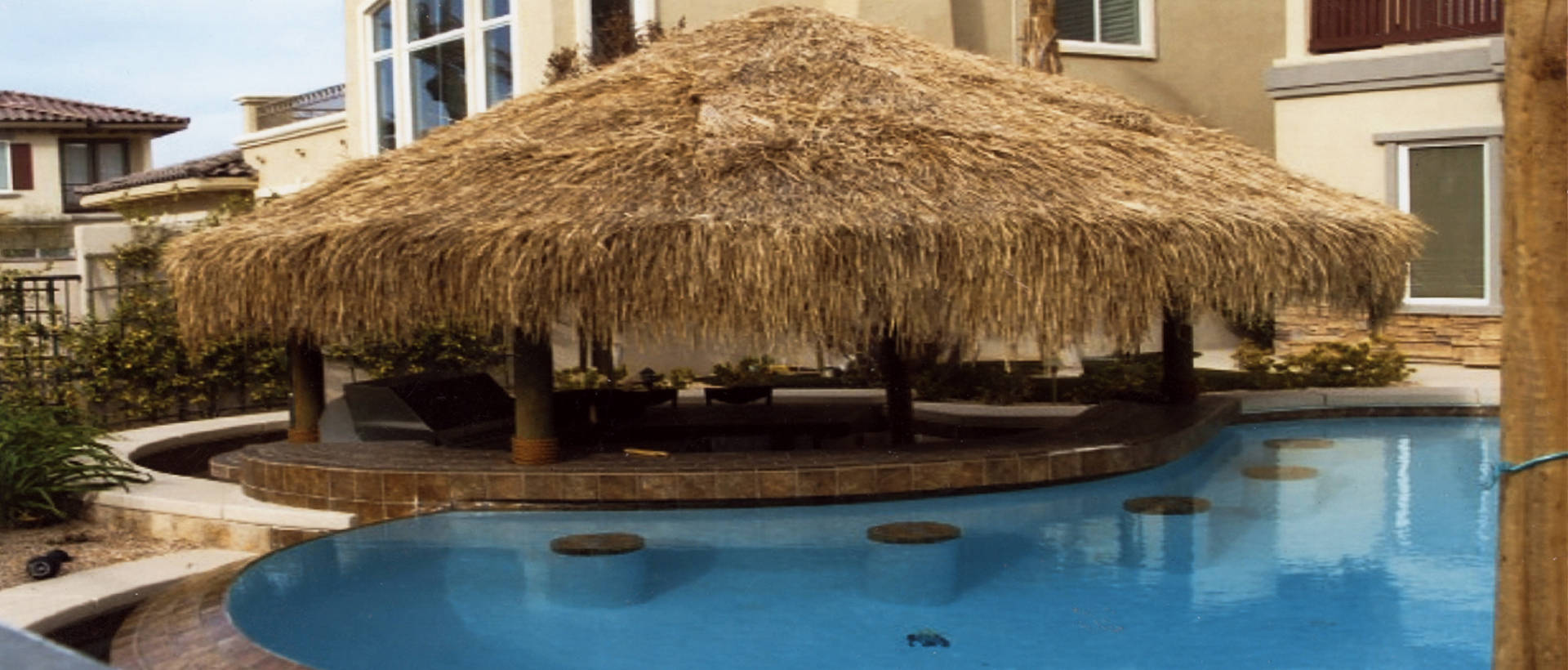 tropical-pool-with-palapa-and-water-seats-SLIDE-opt